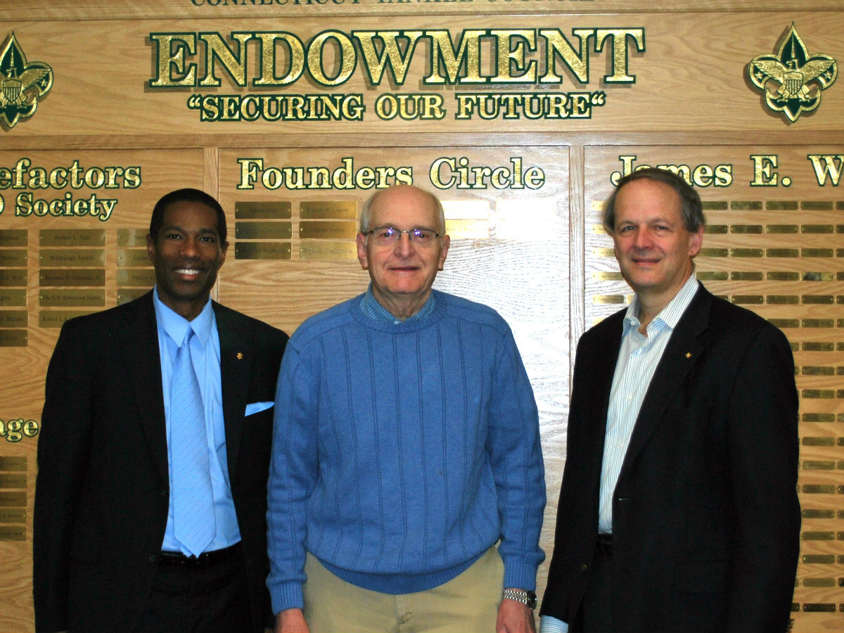 (Photo Caption L-R: Scout Executive Charles Flowers, Mr. Alphonse R. Noë, and Council President Christopher McLeod stand in front of our Endowment Board in the lobby of the Council Resource Center)